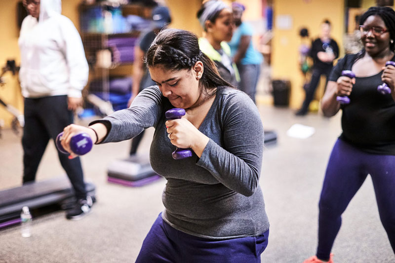 Woman working out in a class